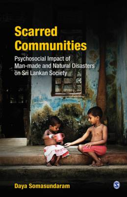 Scarred Communities: Psychosocial Impact of Man-Made and Natural Disasters on Sri Lankan Society (Hardback)